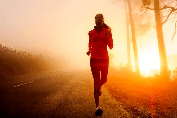 Woman Jogging at sunrise