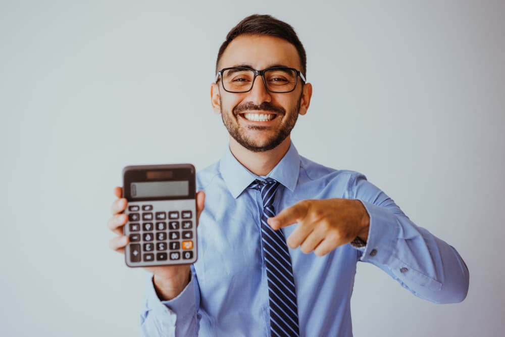 Patient smiling holding a calculator