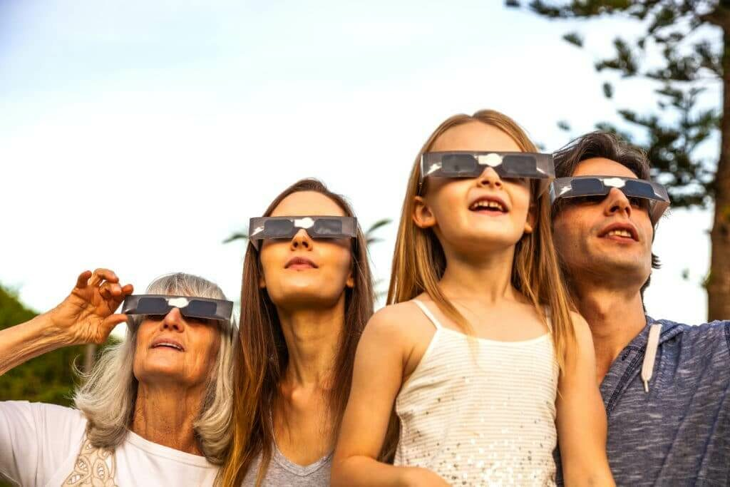 Family watching an eclipse