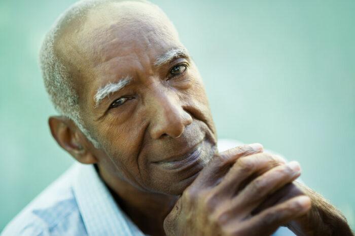 Portrait of happy senior man looking at camera
